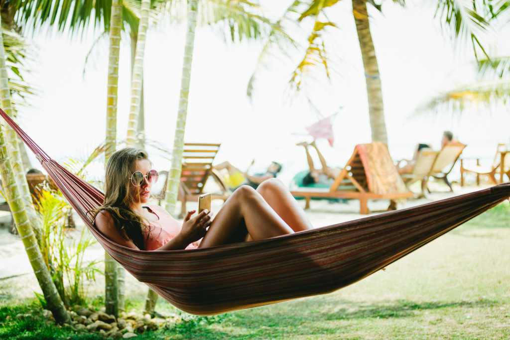 A chick enjoying an afternoon relaxing in a hammock after a surf