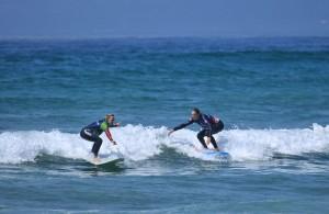 The girls enjoying Muizenberg surf.