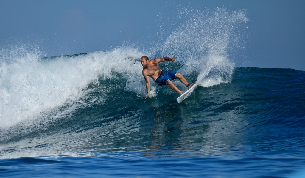 Chris making a perfect turn on a perfect indo wave