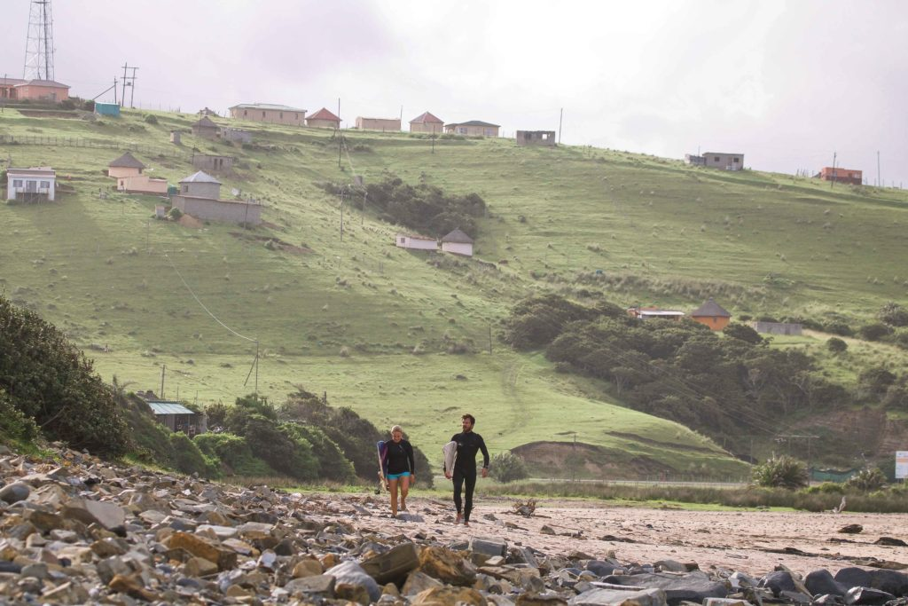walking up the point with the local village in coffee bay